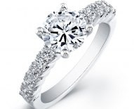 Classic Shared Prong Engagement Ring With Round Brilliant Center
